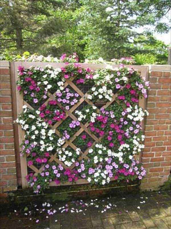 Long brick wall with a lattice planter DIY fence design projects and ideas