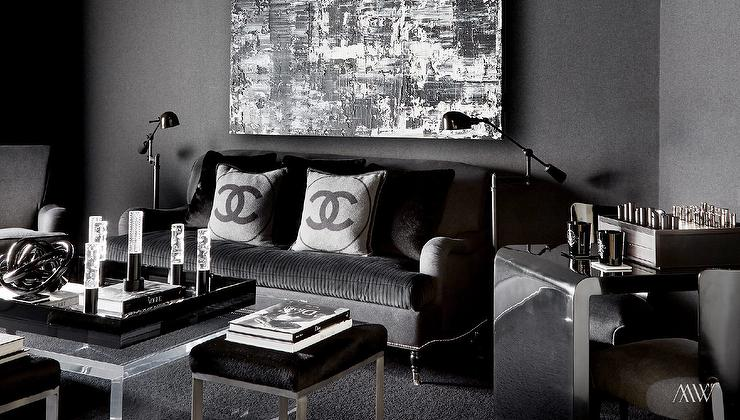 dark -living-room-black-sofa-chanel-pillows-square-lucite-coffee-table