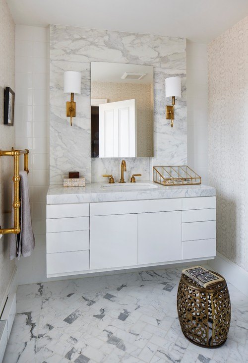 Clean White Bathroom With Gold Accents