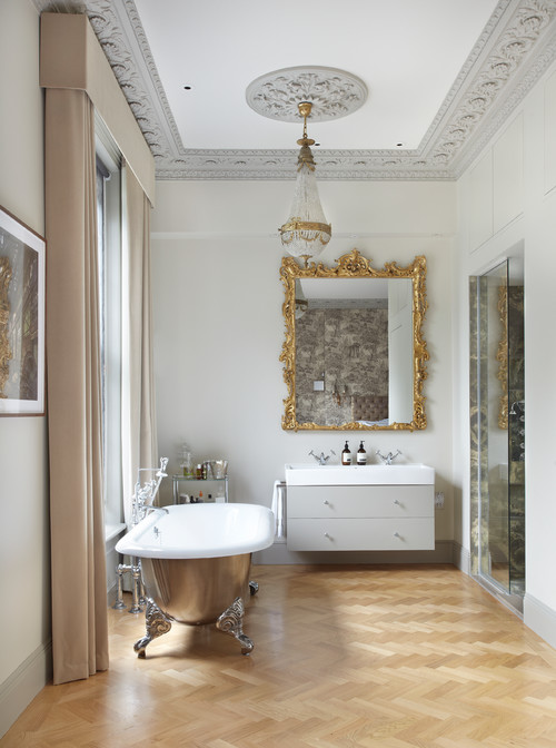 Contemporary bathroom with gold mirror frame