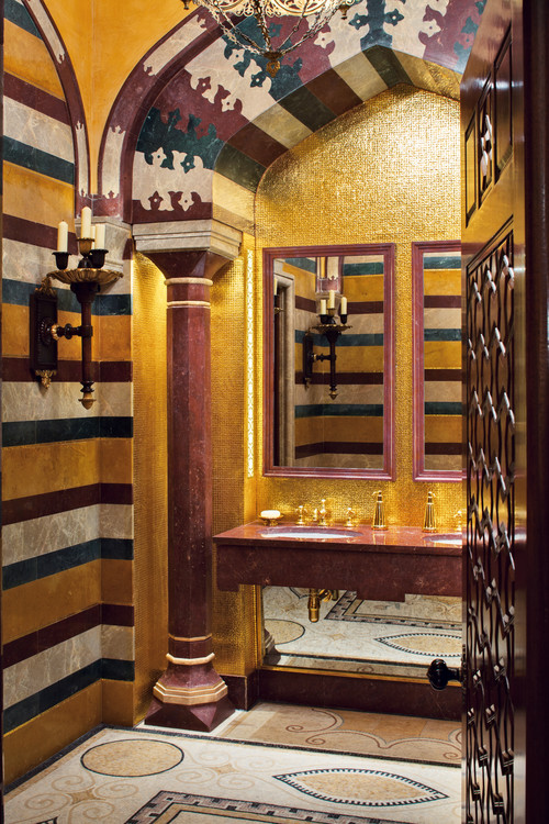 Mediterranean bathroom with an undermount sink and golden details