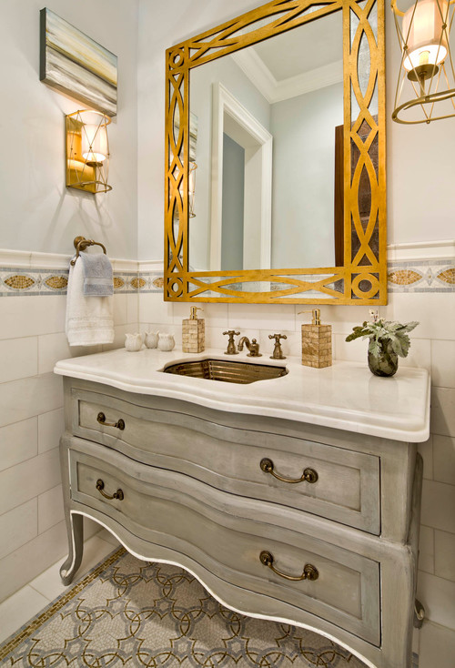 Traditional bathroom with golden color mirror frame