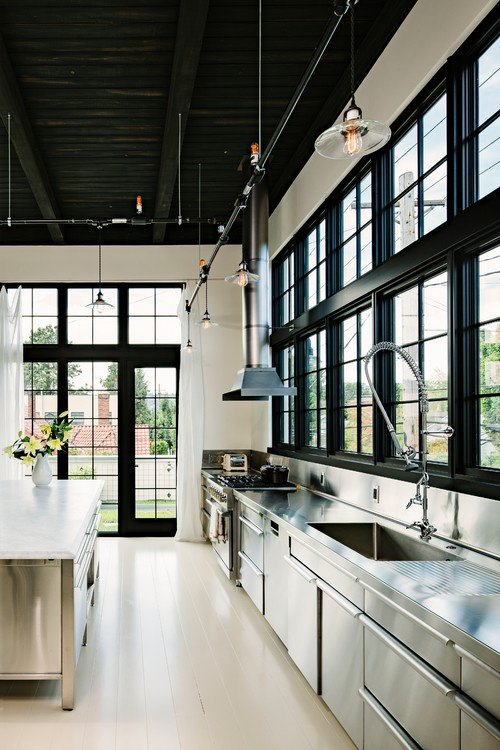 custom stainless cabinetry with industrial details - Industrial Kitchen Ideas
